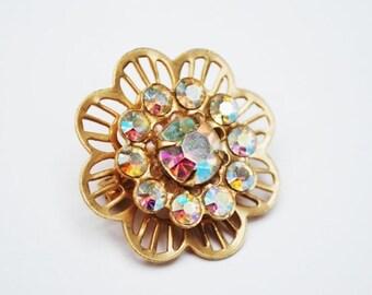 Rhinestone Flower  Brooch   Aurora Borealis Gold tone metal Mid century Pin