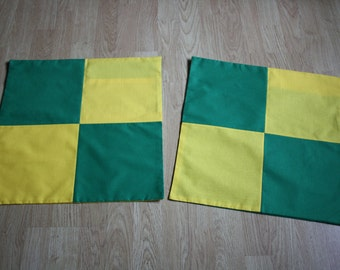 A pair of square envelope cushion covers- Norwich City Canary-style!