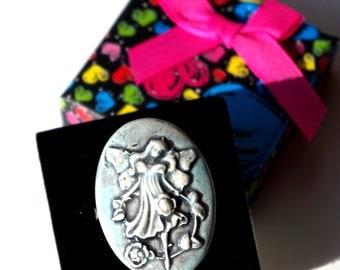 Adjustable ring adorned a cabochon craft ceramic delightful little Elf.