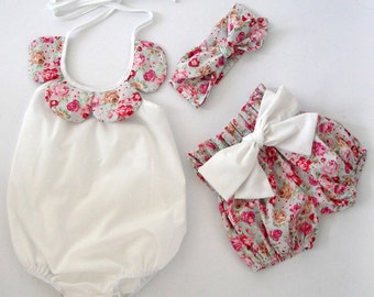 Floral Romper with shorts and head bow.
