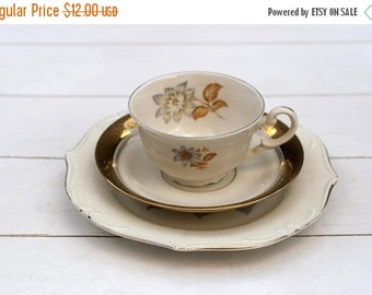 SALE Vintage German Teacup and Saucer Mismatched Trio Set- Ornate Traditional Cream and Gold with Grey Orange Flower