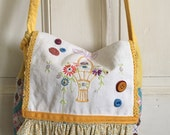 Handmade Vintage Feedsack messenger bag with vintage embroidery and button accent