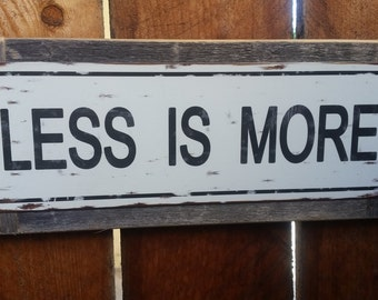 "Recycled wood framed ""Less is More"" street sign"