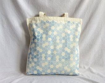 Heavy-duty canvas tote bag hand-printed with 'Honeycomb' design in blue