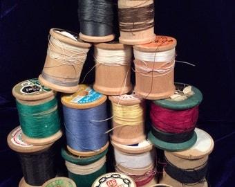 seventeen vintage wooden thread spools