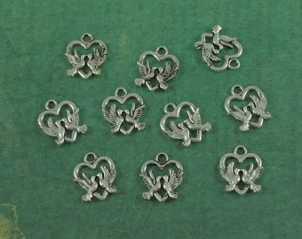 Silver Kissing Doves Flying Over a Heart Charm - Package of 10 pieces