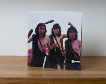The Ugs - a greetings card showing men dressed as cavemen at Glastonbury Festival