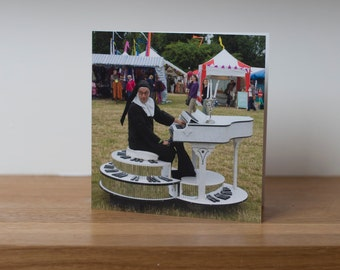 Musical Ruth- a comedy nun on a motorised piano at Larmer Tree festival