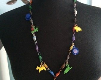 Metal charm folk art necklace