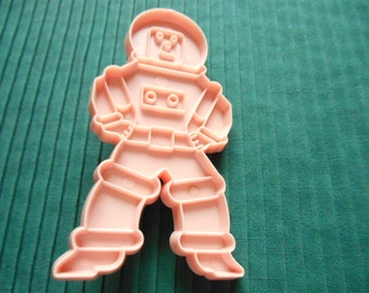 Pink Vintage Spaceman Cookie Cutter from Stanley Home Products. 4.75 inch by 2 5/8 inch