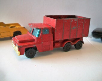 VINTAGE 1960s Red Husky Guy Warrior Coal Truck Scale 1.64 Toy Car