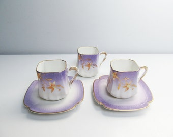 Antique 2 Porcelain Cups and Saucers, porcelain demitasse, china demitasse, cream color, gold rim and decoration, hand painted flower motif