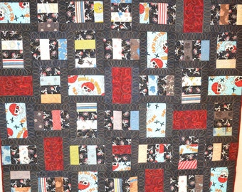 Quilted wall hanging or lap quilt. Pirates, Pirates, Pirates. Machine pieced and quilted