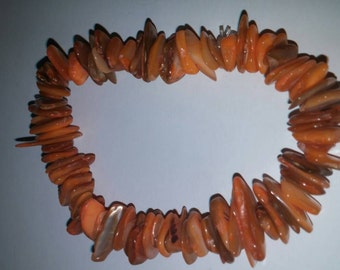 Stretchy orange bracelet