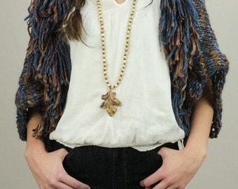 Knitted boho shrug, hippie shrug, bolero jacket in navy blue and brown with fringe