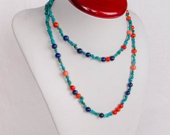 Long necklace with Turquoise stones and blue lapis and red coral beads