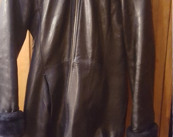 BURBERRY Hooded  Genuine Leather With Faux Lined Hood Cuffs And Upper Lapel Zipper Front Size XS  Two  Front Side Pockets Sold As Is