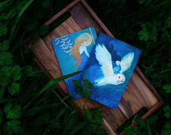 """A5 notebooks x 2, """"Fly me to your dreams"""" and """"Daughter of the Night"""" designs"""