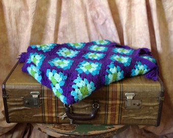 Beautiful vintage purple, turquoise blue and green afghan blanket.