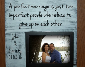 A perfect marriage is just two imperfect people who refuse to give up on each other wood sign with picture frame - holds a 5 x 7 photo