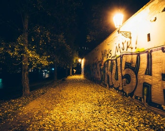 Graffiti on a wall at night, along the Vltava, in Prague, Czech Republic. | Photo Print, Stretched Canvas, or Metal Print.
