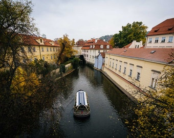 View of autumn color and buildings along Čertovka, in Prague, Czech Republic. | Photo Print, Stretched Canvas, or Metal Print.