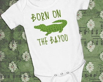 Alligator Born on the Bayou, on White onsie Snap bottom all in one bodysuit