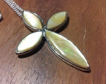 Womans cross pendant necklace with sterling silver chain.