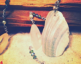 Sea shell necklace from the outerbanks on silver chain with pearls and glass beads.