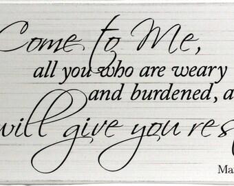Hand made sign of Matthew 11:28.