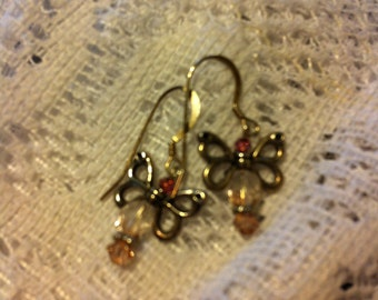 Vintage rose and silver butterfly pierced earrings.