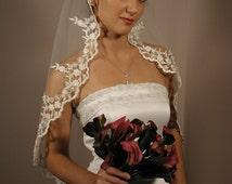 "Mantilla wedding veil. Circular cut 42"" long fingertip length with silver trimmed."