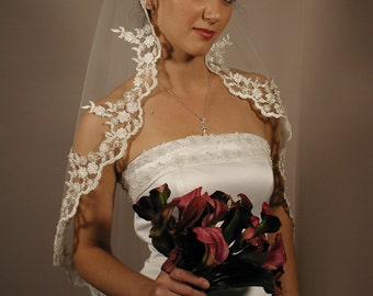 "Mantilla wedding veil. Circular cut 42"" long fingertip length with silver trimmed."
