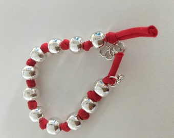 Red fabric silver beads