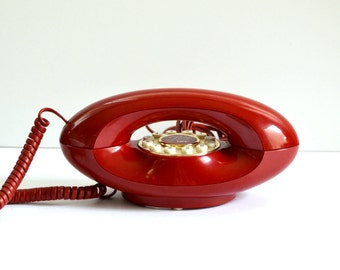 Red vintage rotary telephone French