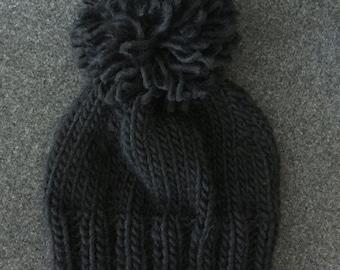 Hand knitted wool pom pom beanie