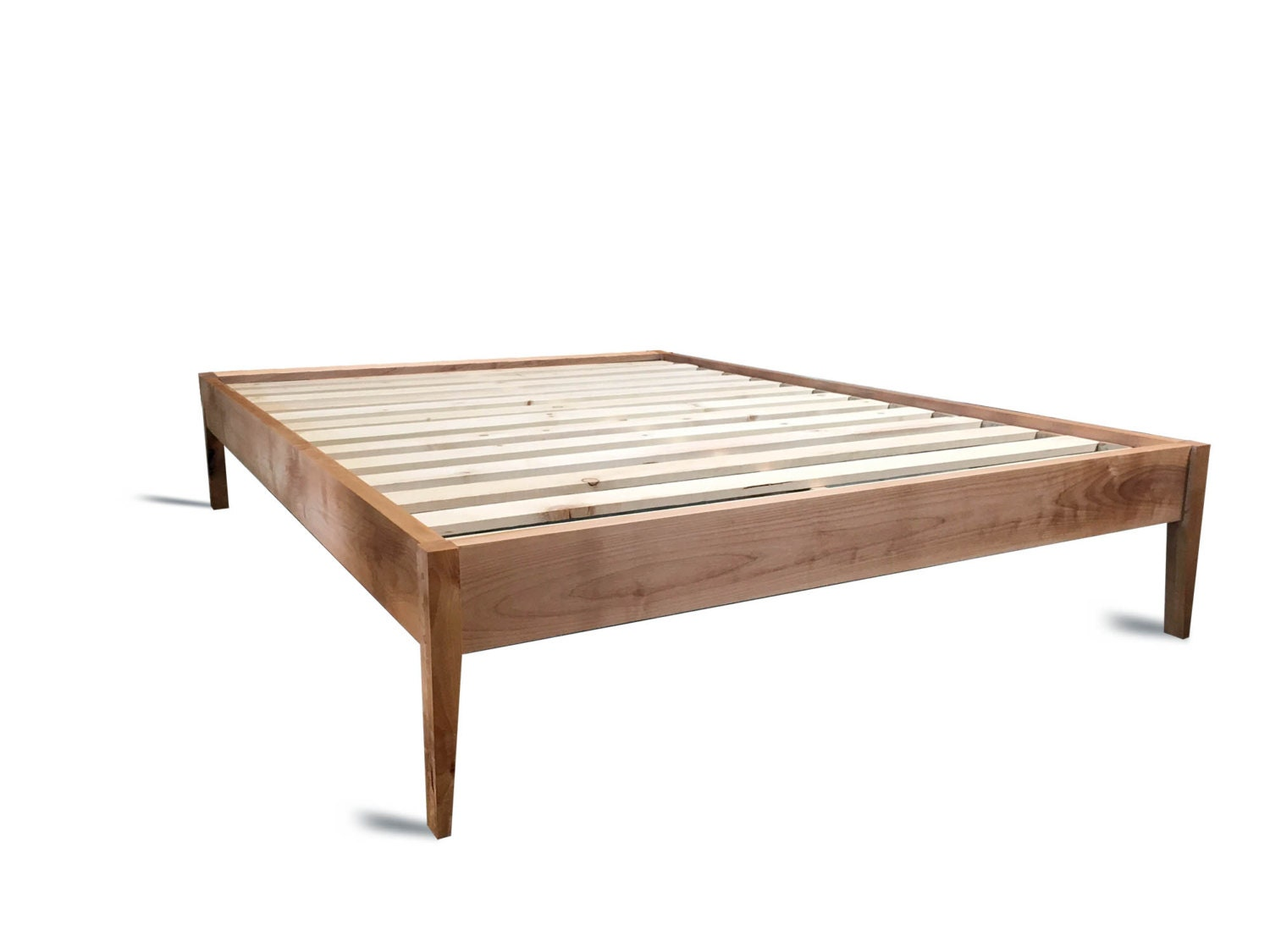 Platform bed frame simple wood bed with sleek tapered legs Simple wood bed frame designs