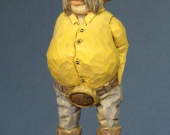 hand carved caricature wooden cowboy figure