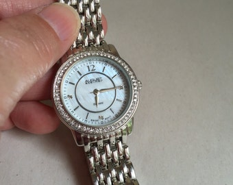 August Steiner diamond watch mother of pearl face swiss movement stainless steel band water resistant 33 feet