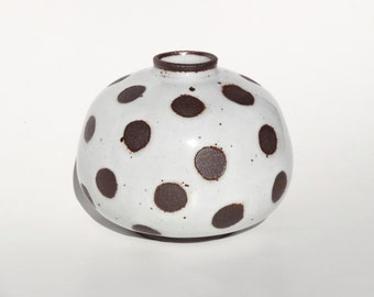 Handmade white ceramic vase with exposed black/brown clay dots