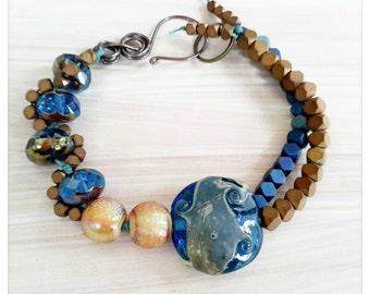 Blue lampwork bracelet - blue and bronze bracelet - Irish linen cord bracelet - hematite cubes