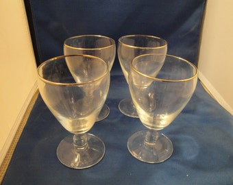 Set Of 4 Footed Goblet/Wine Glasses With All Around Gold Rims.
