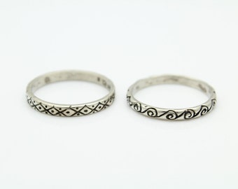 Lot of Two Tribal-Design Stacking Band Rings in Sterling Silver Size 9.5. [11463]