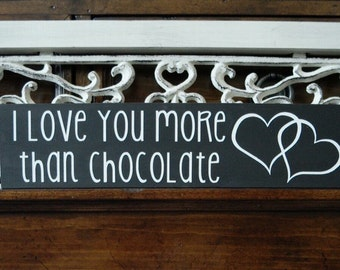"""3 1/2""""x15"""" black and white """"I love you more than chocolate"""" wood sign with double-heart art"""