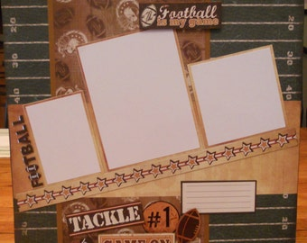 """12x12 premade scrapbook page. """"Football is my game"""""""