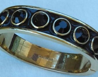 Vintage Givenchy hinged, bangle bracelet gold-plated  black enamel and 8 black glass stones