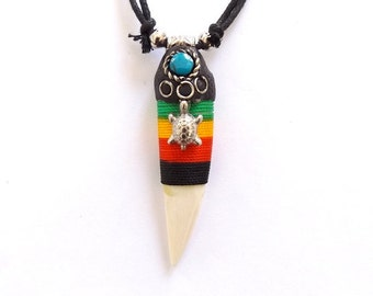 Real bone tooth shaped cord surf style necklace, adjustable, in Jamaican Rasta colours with turtle.