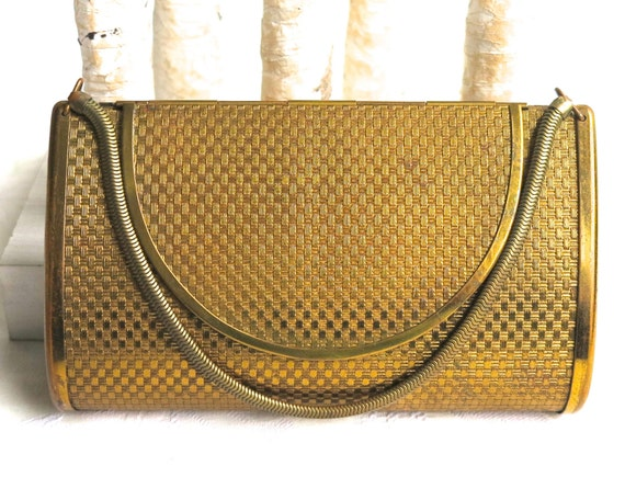 Vintage gold metal Volupte box purse, made in United States, engine turned exterior, foldover closure, internal mirror, circa 1950s