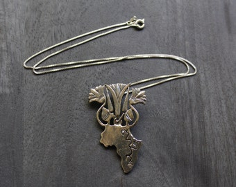 Sterling Silver Africa with Blooming Lotus Flowers