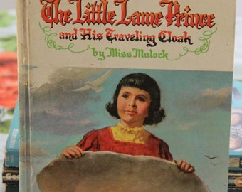 A striking first edition 1964  The Little Lame Prince and his Travelling Cloak by Miss Mulock